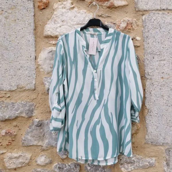 Blusa azul celeste y blanca zebra manga larga. talla única